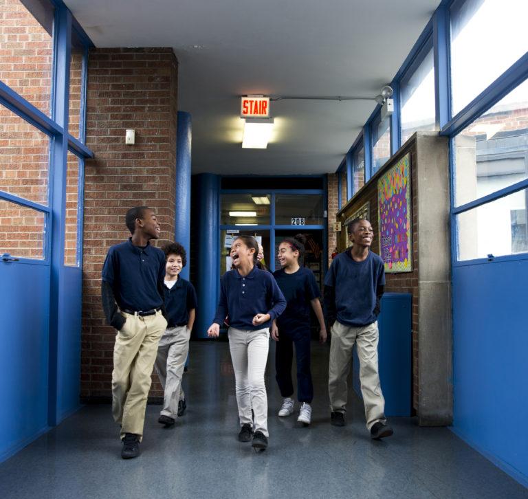 kids walking down hall